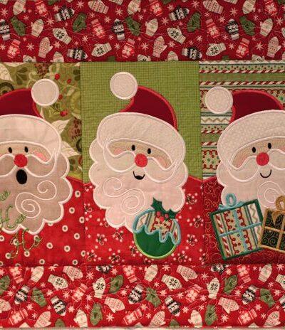 Die Santas fertig zum Quilten